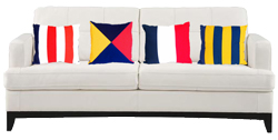 White Sofa With Nautical Flag Throw Pillows